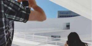 Dos personas fotografiando el Patio Elíptico del Centro Cultural CajaGranada y la sede de Bankia en Andalucía